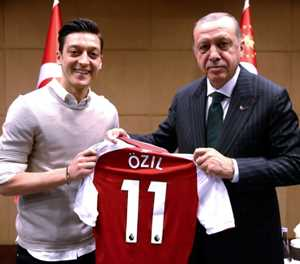 Merkel aide 'sad' about Ozil's wedding invite to Erdogan