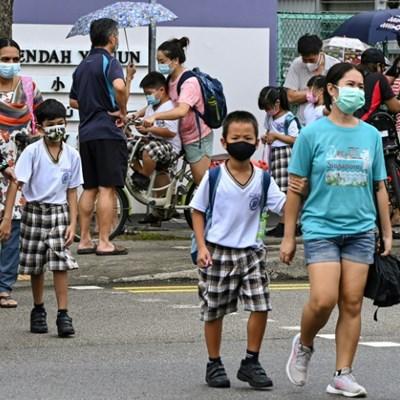 Singapore warns new virus strains infecting more children, shuts schools