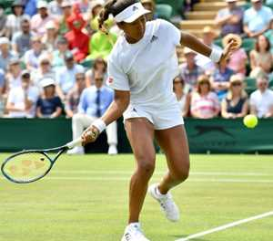 Osaka not at home on grass