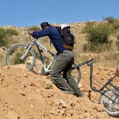 Bolivian teacher on a bike brings school to pupils