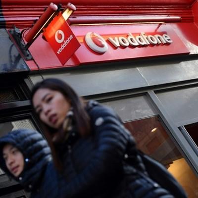Vodafone slashes dividend after vast annual loss