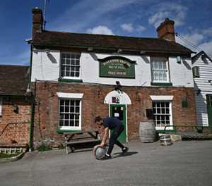 English pubs set for comeback, India battles record virus surge