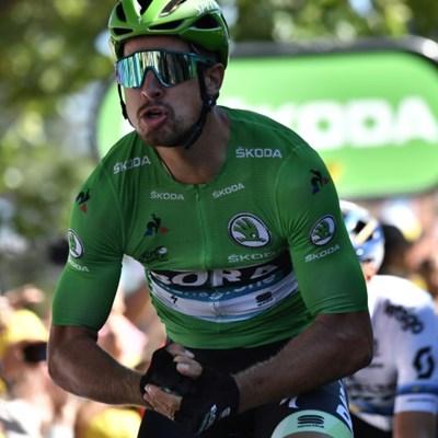 Sagan shines as Tour de France mountain summits loom