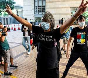 Hong Kong judges say prison staff wrong to cut dissident's hair