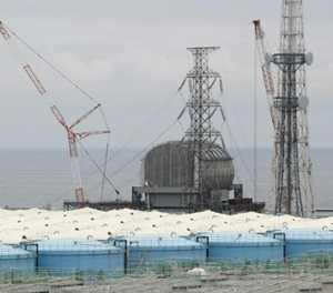 Robot lifts bits of melted fuel at Japan's Fukushima plant