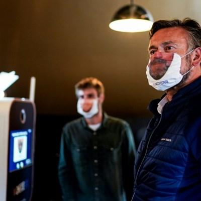 Printed masks put smile on Belgian faces as lockdown ends