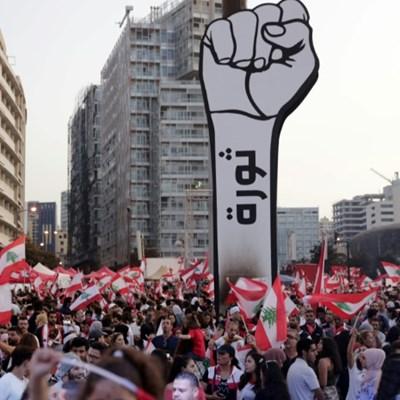 Lebanon protesters block roads to keep revolt alive