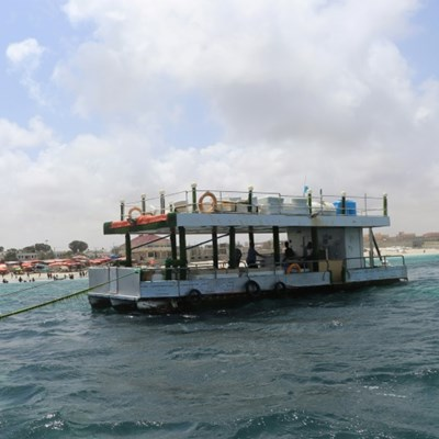 Far from the bombs: Somalis relax on floating restaurant