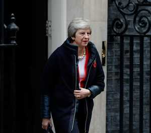 UK's May takes Brexit deal to cabinet as MPs revolt