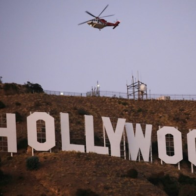 Six held after Tinseltown's famous sign changed to 'Hollyboob'