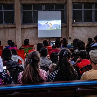 Mobile cinema brings movie magic to Syria Kurd children