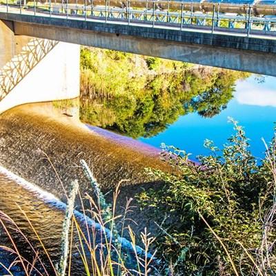 Dam overflows, 'but please keep saving'