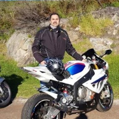 Motorfietsryer se herstel vorder