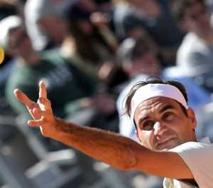 Federer eases into third round in Rome