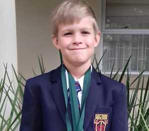 Caleb a champion swimmer