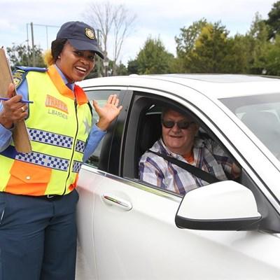 Singing traffic officer makes driver's birthday