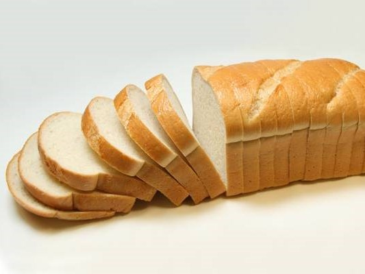 Shop-bought white bread in focus