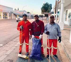 Street cleaners sweep with a smile