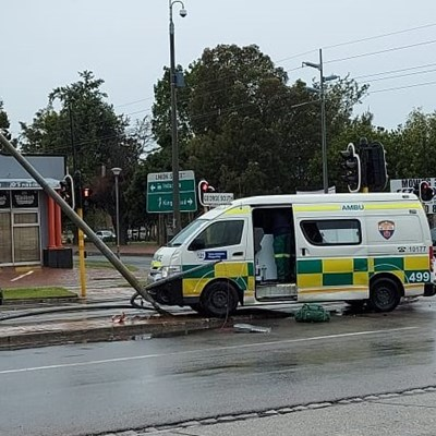 Ambulance hits lamp post in York Street