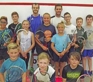 Coached in squash